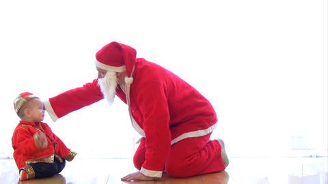 Santa Claus crawling with baby Footage