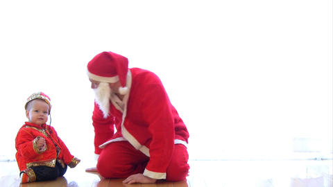 Santa Claus crawling with baby Stock Video Footage