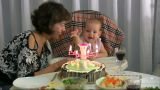 Mum Celebrating Birthday For Baby stock footage