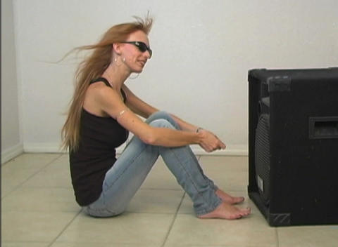 Sexy Redhead in Front of a Speaker-1 Stock Video Footage