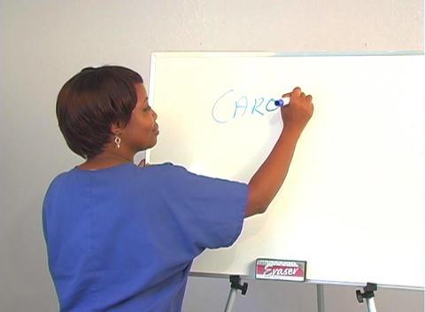 "Beautiful Nurse Writes ""Carotid Endarterectomy"" on a... Stock Video Footage"