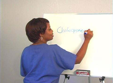 "Beautiful Nurse Writes ""Cholecystectomy"" on a White Board Stock Video Footage"