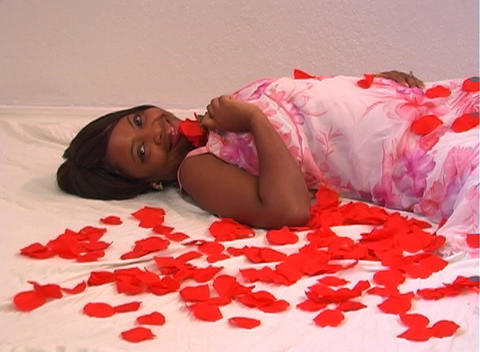 Beautiful Woman Lying Amidst Rose Petals (3) Stock Video Footage