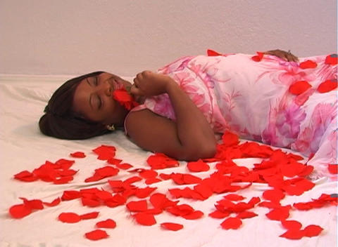 Beautiful Woman Lying Amidst Rose Petals (3) Footage