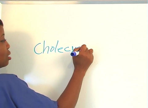 "Beautiful Nurse Writes ""Cholecystectomy"" on a White Board... Stock Video Footage"