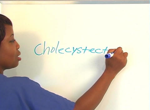 "Beautiful Nurse Writes ""Cholecystectomy"" on a White Board (close-up) Footage"