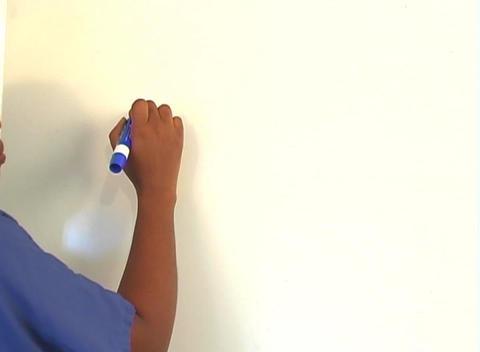 "Beautiful Nurse Writes ""Debridement"" on a White Board... Stock Video Footage"