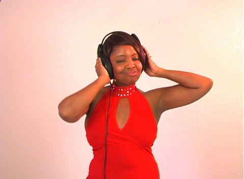 Beautiful Woman Listens to Music with Headphones (3) Stock Video Footage