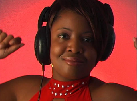 Beautiful Woman Listens to Music with Headphones (6) Footage