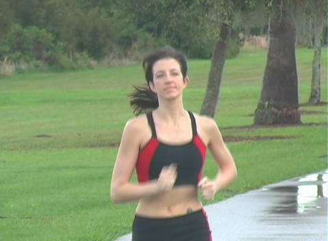 Beautiful Woman Jogging (2) Stock Video Footage