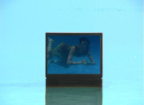 Beautiful Brunette Underwater on TV Stock Video Footage