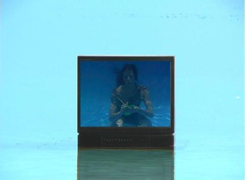 Beautiful Brunette Underwater on TV Stock Video Footage