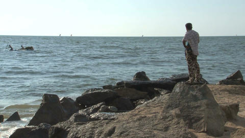 Man standing near the sea Stock Video Footage