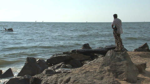 Man standing near the sea Footage