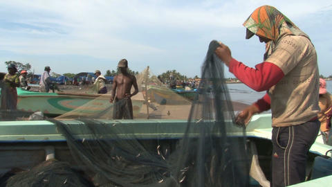 Fisher man on the beach Stock Video Footage