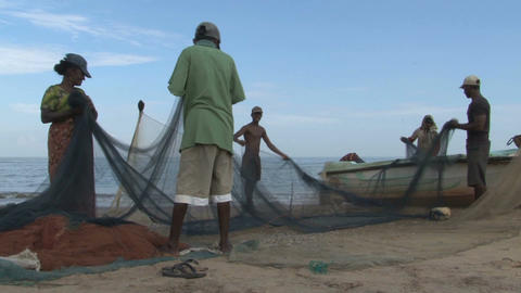 Fishers on the beach Stock Video Footage