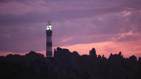 Powerful lighthouse illuminated in sunset Stock Video Footage