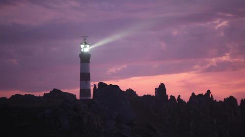 Powerful lighthouse illuminated in sunset Footage