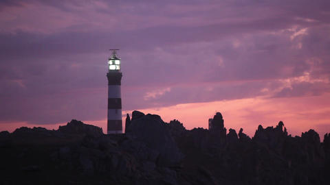 Powerful lighthouse illuminated in sunset Stock Video Footage