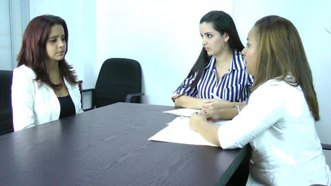A young businesswoman being fired by her managers Stock Video Footage