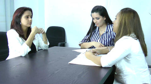 A young businesswoman being fired by her managers Footage