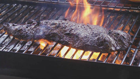 steak sizzle on flaming and smoking grill Stock Video Footage