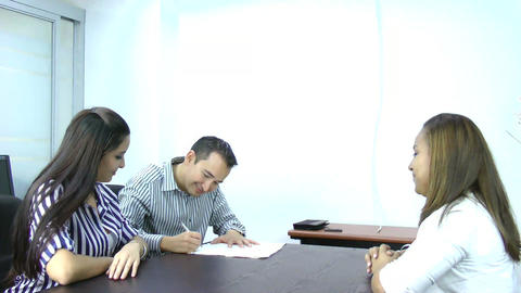 Young Couple Sign Document stock footage