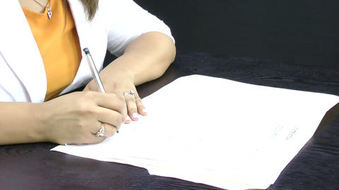 A businesswoman signs some documents Stock Video Footage