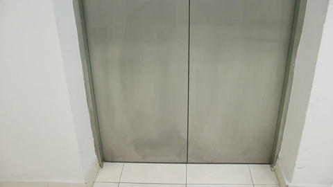 Woman uses elevator Stock Video Footage