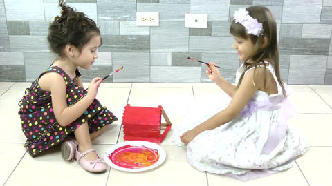 two sisters on the floor enjoying painting Stock Video Footage