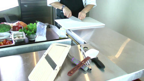 chef cutting garlic in a professional kitchen Stock Video Footage