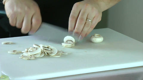 chef working in the kitchen chopping champignons Stock Video Footage