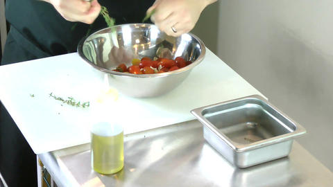 Chef preparing fresh herbs and tomatoes for grille Footage