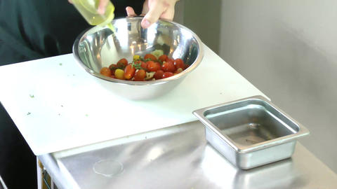 Chef preparing fresh herbs and tomatoes for grille Stock Video Footage