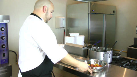 chef putting baking pan with tomatoes into oven Stock Video Footage