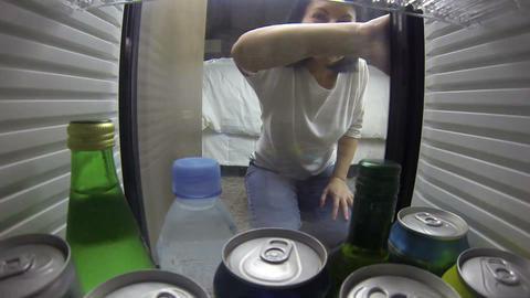 woman opening the fridge. Taking something to drin Stock Video Footage