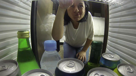 Woman Opening The Fridge. Taking Something To Drin stock footage