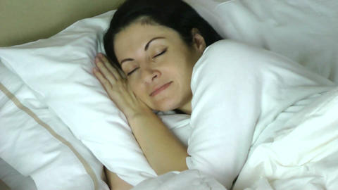 woman sleeping on her bed at home having a very ha Footage