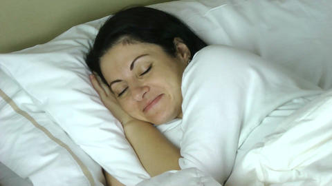 woman sleeping on her bed at home having a very ha Stock Video Footage