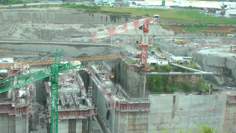 Crane moving in a big area of construction Stock Video Footage