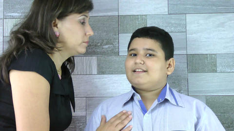 Mother whispers secret to her son Stock Video Footage