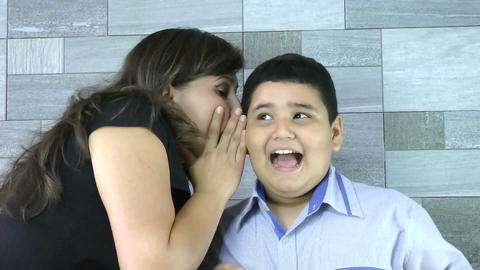Mother whispers secret to her son Footage