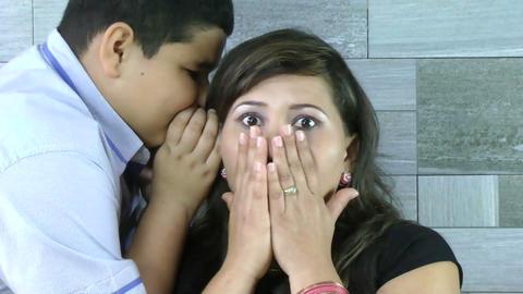 Scary secrets. Boy telling an impressive secret to Stock Video Footage