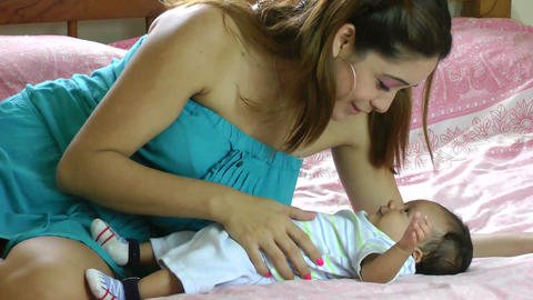Hispanic mother playing with her baby infant Stock Video Footage