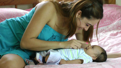 Hispanic Mother Playing With Her Baby Infant stock footage