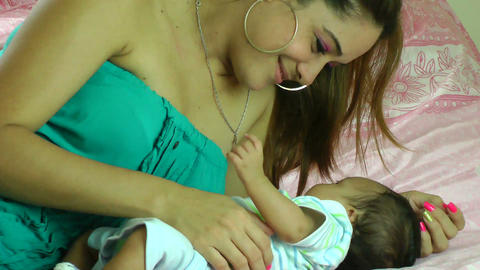 young Hispanic woman playing with her little baby Footage