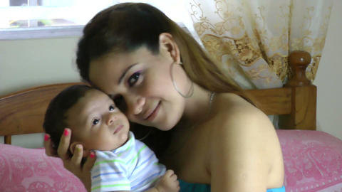 mother with newborn baby at home Stock Video Footage