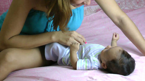 Mother having fun with her little newborn baby Stock Video Footage