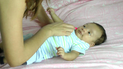 Mother making her baby to smile Stock Video Footage
