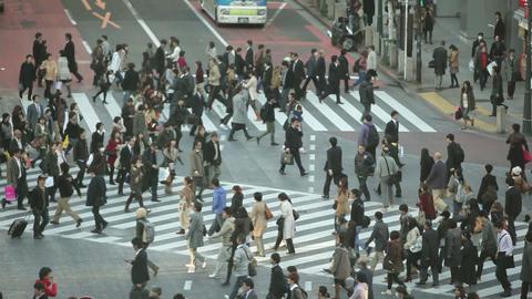 Crowd crossing street in Japan Footage